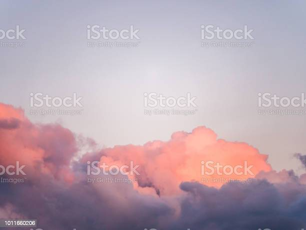 Photo of Gorgeous close up view of fluffy cumulus clouds with pink and purple hues resembling delicious mouthwatering cotton candy.