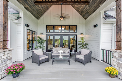Wood panel vaulted covering on outdoor gathering area of new home
