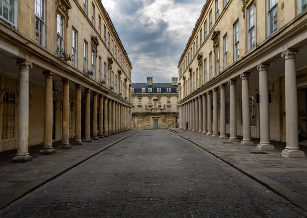 Gorgeous deserted street in Bath, England with Georgian columns Gorgeous deserted street in Bath, England with Georgian columns on a cloudy day. bath england stock pictures, royalty-free photos & images