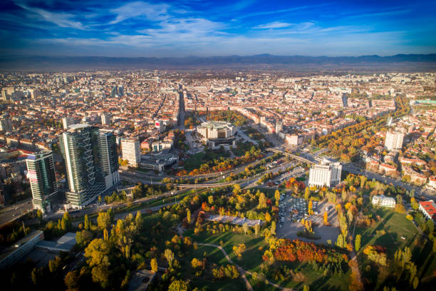 Gorgeous drone shot above Sofia city downtown in autumn Majestic wide aerial drone urban shot of Sofia city downtown. National Palace of Culture (NDK). The shot was taken near sunset with DJI Phantom 4 Pro drone / quadcopter. bulgaria stock pictures, royalty-free photos & images
