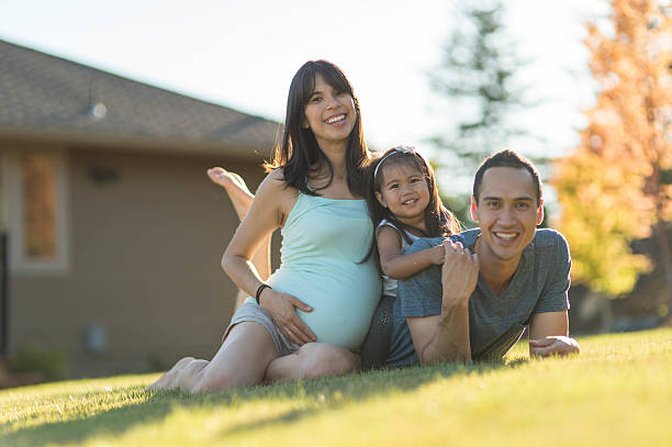 gorgeous ethnic family spending time together outdoors - hawaiian ethnicity stock photos and pictures