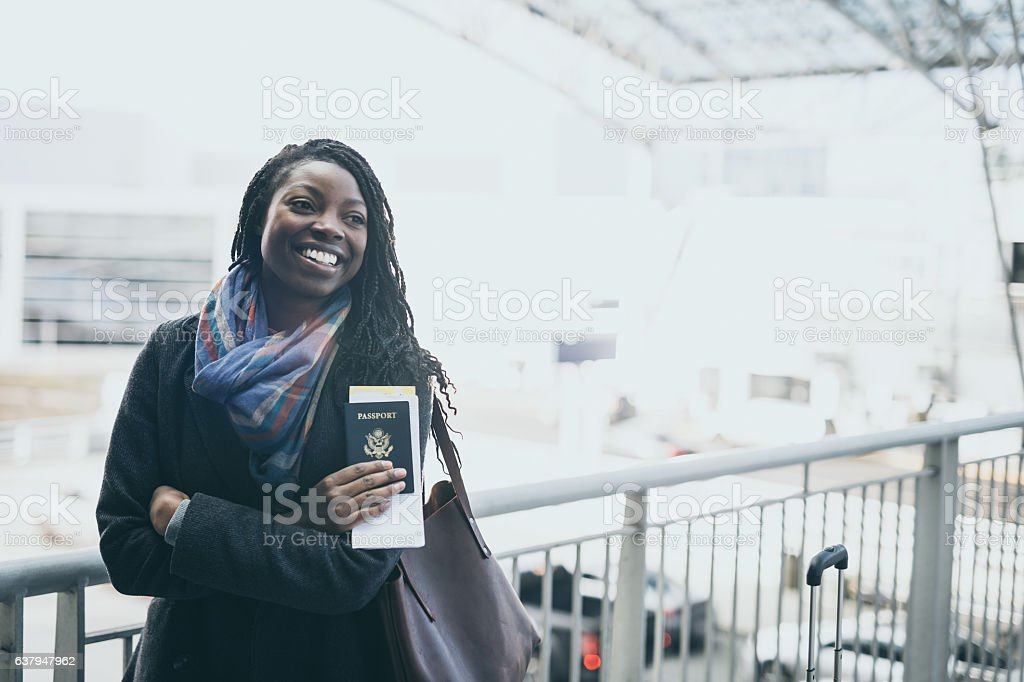 A gorgeous ethnic young adult female is traveling stock photo