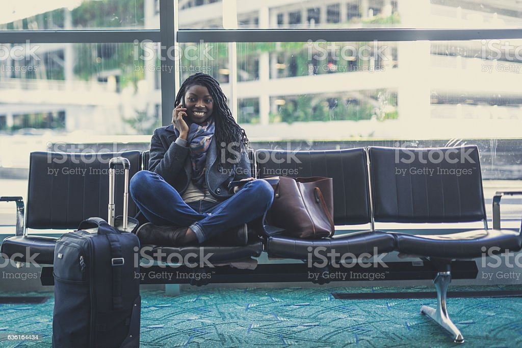 Gorgeous ethnic young adult female traveling stock photo