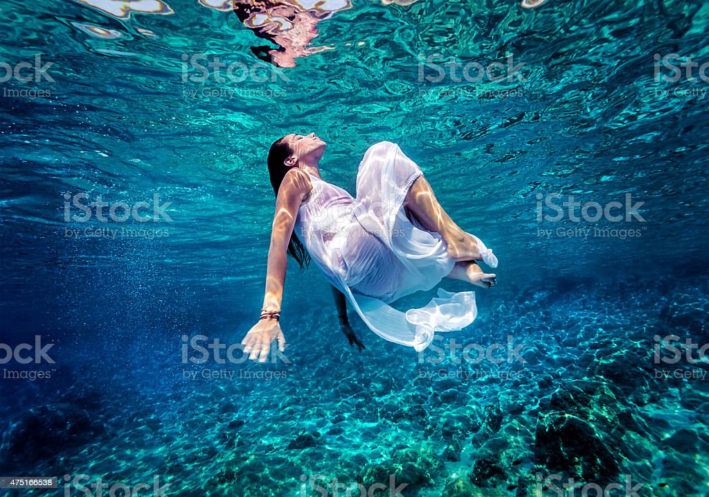 Gorgeous female dancing underwater stock photo