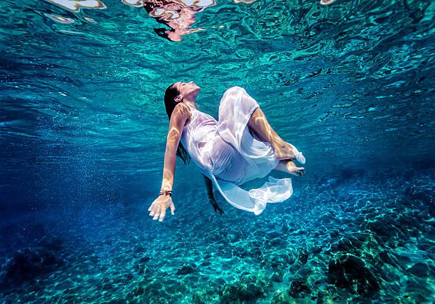 Gorgeous female dancing underwater stock photo