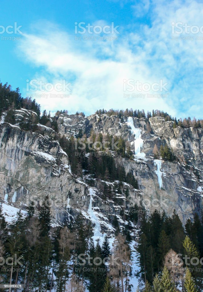 gorgeous frozen waterfall in the Swiss Alps near St. Moritz on a beautiful winter day stock photo