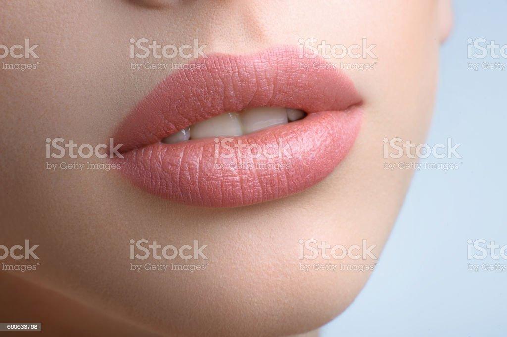 Gorgeous full lips of a beautiful woman stock photo