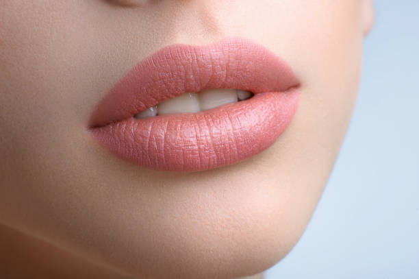gorgeous full lips of a beautiful woman - human lips stock photos and pictures