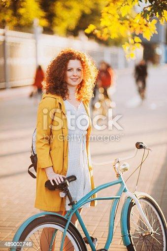 istock Gorgeous girl with bike 489002746