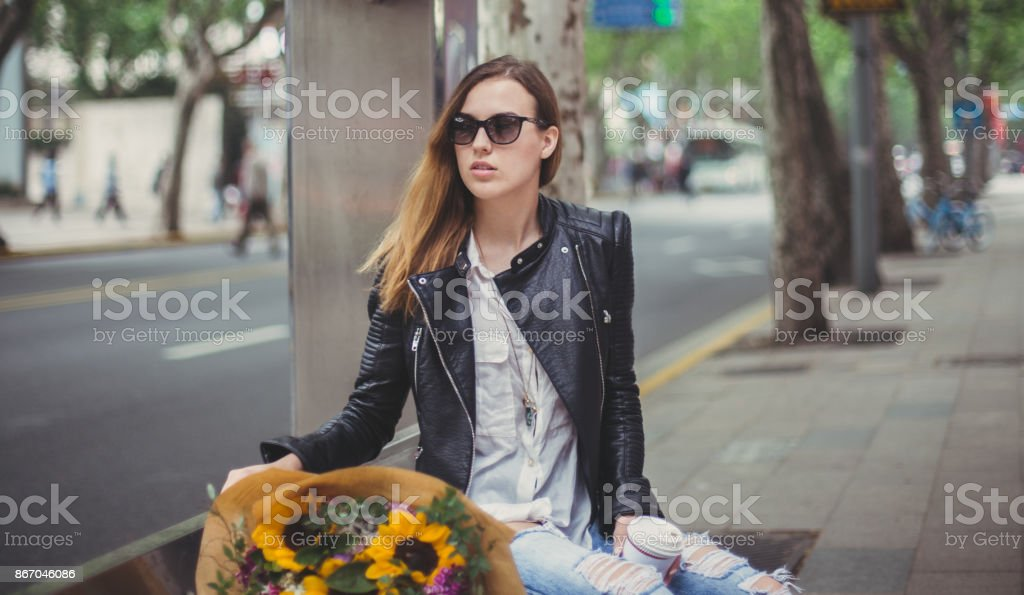 Gorgeous girl with some flowers stock photo