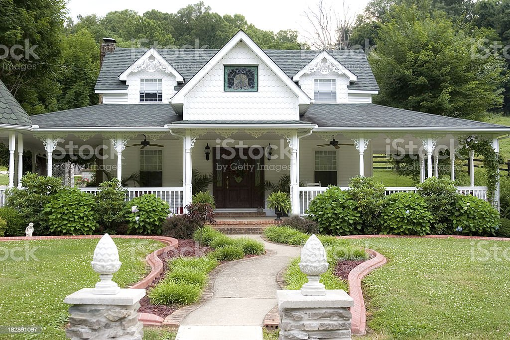 Gorgeous home with wrap-around porch stock photo