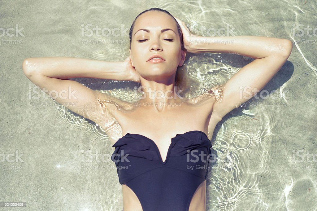 Gorgeous lady in seawater stock photo