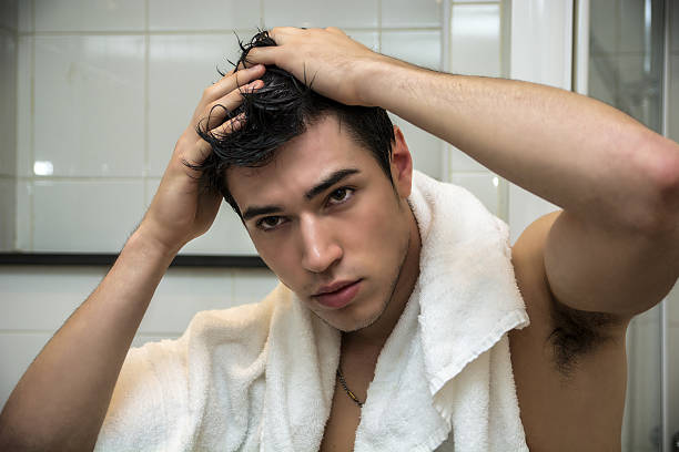 Gorgeous Man after Shower Holding his Head stock photo