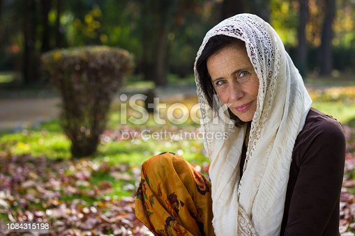 Middle aged beautiful lady with muslim look outdoors