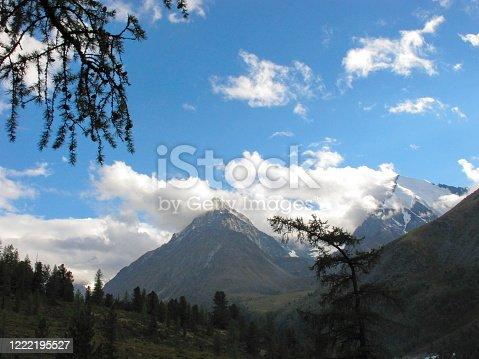 istock Gorgeous mountainous landscape. Crown of Altai summit in clouds. Katun Mountain range. Altai Republic, Siberia, Russia. 1222195527
