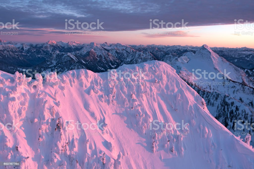 Gorgeous Pink Colored Mountains Pacific Northwest Cascades Sunset Pink Lighting stock photo