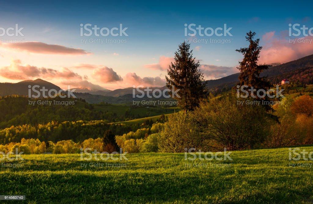 gorgeous purple sunset in mountainous countryside stock photo