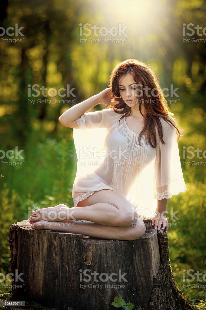 Gorgeous Redhead In Garden On Stump Royalty Free Stock Photo