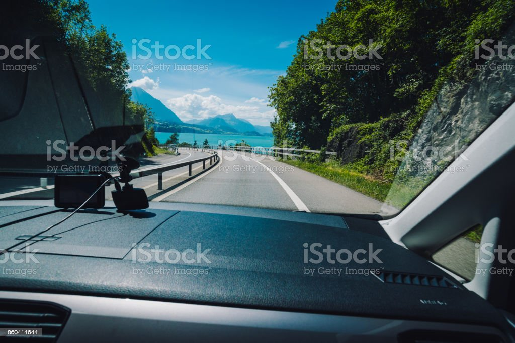 gorgeous scenery view of lakeside road in stock photo