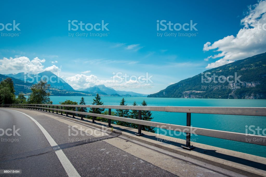 gorgeous scenery view of lakeside road stock photo