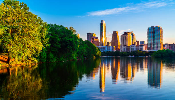 Gorgeous Summer sunrise along Shoreline Town Lake Reflections Austin , Texas , USA Skyline Cityscape Austin , Texas - at sunrise golden hour with perfect mirrored reflection cityscape - Gorgeous Summer sunrise along Shoreline Town Lake Reflections Austin , Texas , USA Skyline Cityscape perfect downtown reflection off the Colorado River with trees in reflection along side of lake reflection lake stock pictures, royalty-free photos & images