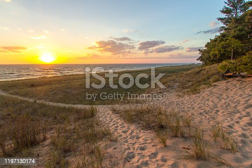 832047798 istock photo Gorgeous Sunset Beach Trail On Lake Michigan Coast 1197130174