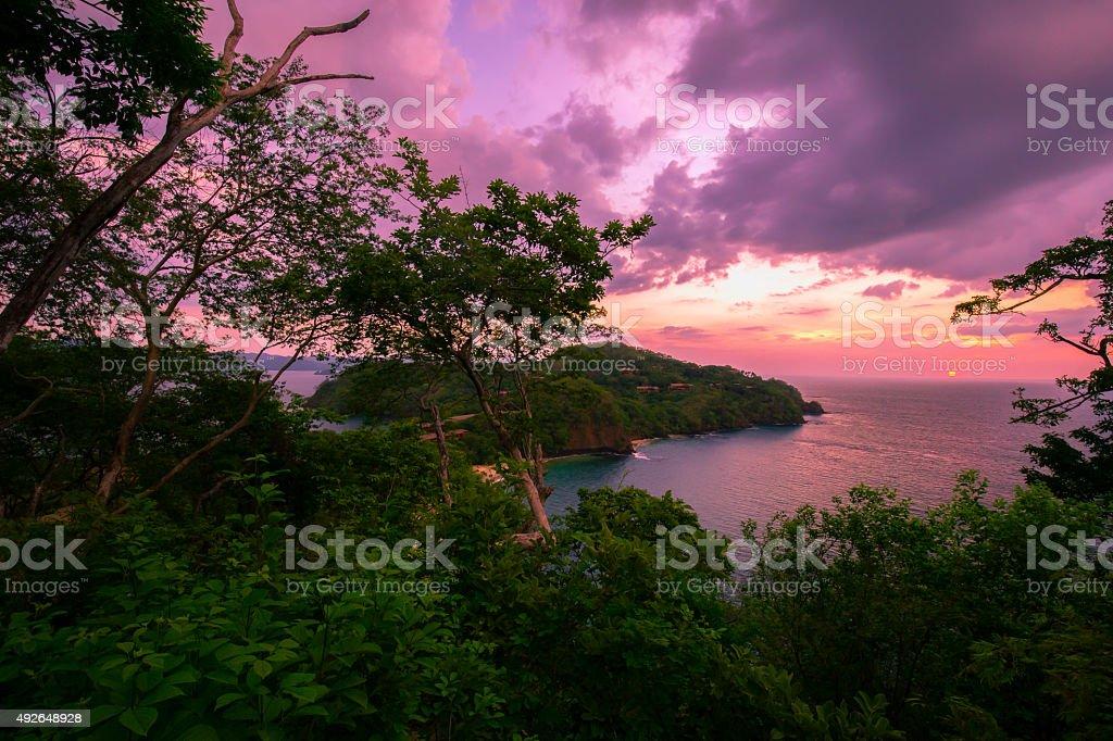 Gorgeous sunset over Coast Rica coastline stock photo