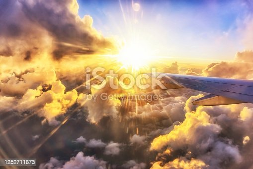 1045890176 istock photo Gorgeous sunset through the plane window at golden hour 1252711673