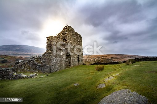 Gorgeous sunset view of the crumbling walls of Dolwyddelan Ruins in Snowdonia National Park, Wales UK.
