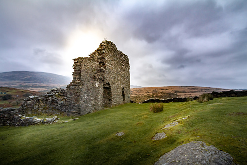 Gorgeous sunset view of the crumbling walls of Dolwyddelan Ruins in Snowdonia National Park, Wales