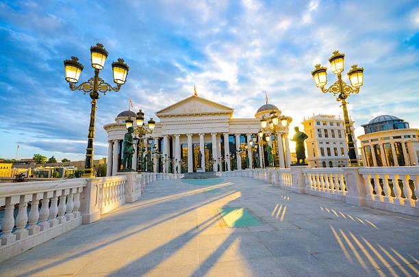 a gorgeous view of a sunrise of macedonian museum in skopje - üsküp stok fotoğraflar ve resimler