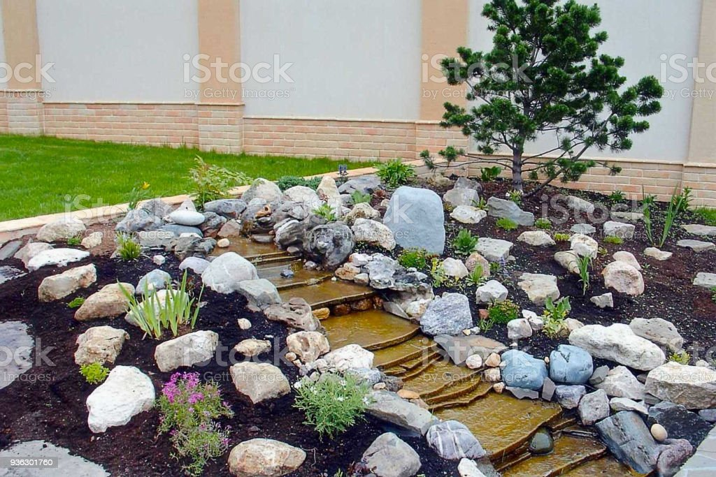 Gorgeous View Of Exterior Of A Private Garden. Landscape Design Called  Alpine Slide. Decorative