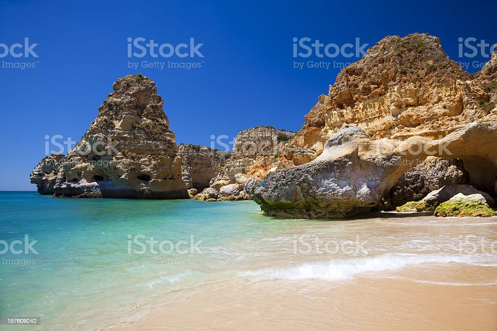 A gorgeous view of the water in Praia da Marinha stock photo