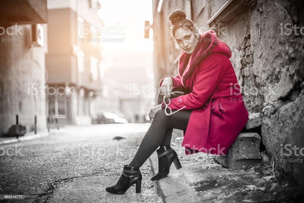 Gorgeous woman in a red coat stock photo