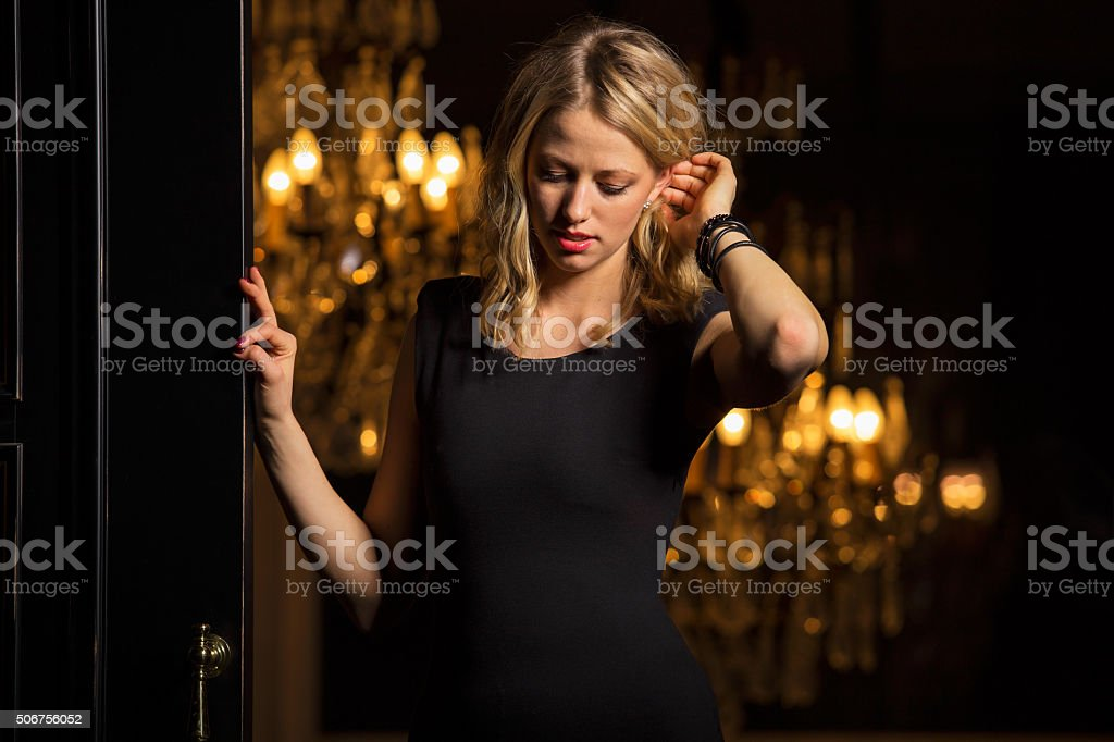Gorgeous woman in black dress stock photo