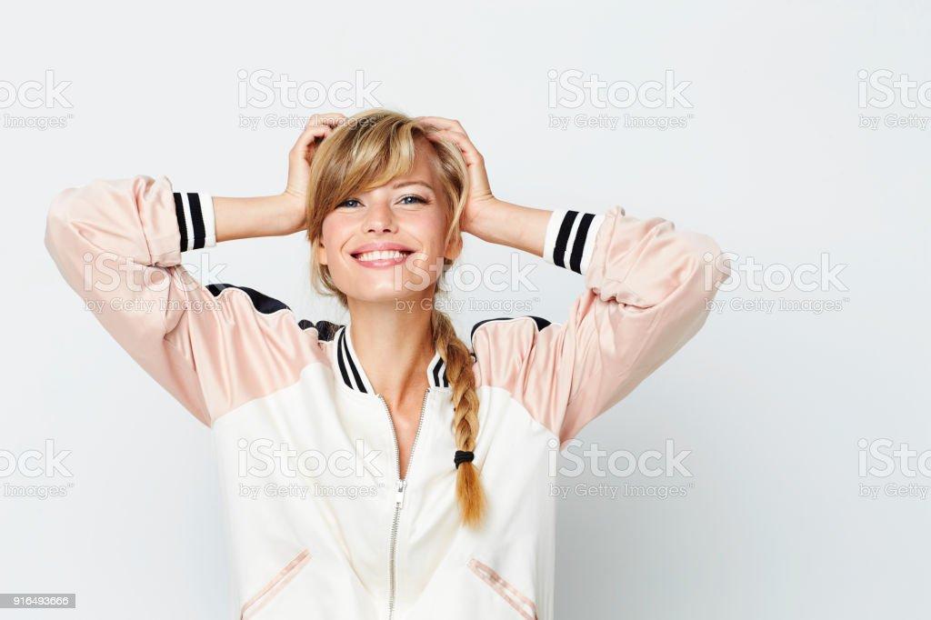 Gorgeous woman in varsity jacket – zdjęcie