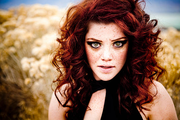 gorgeous woman - woman green eyes red hair stock photos and pictures