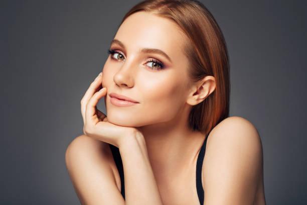Gorgeous woman posing on camera stock photo
