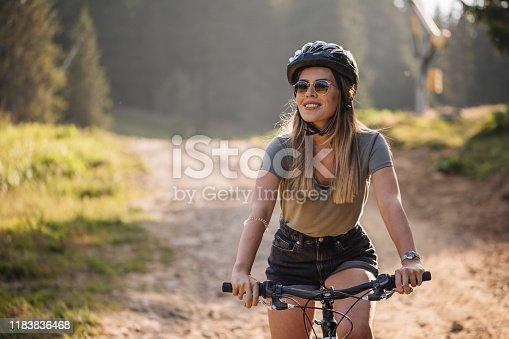 Woman riding a mountain bike during summer