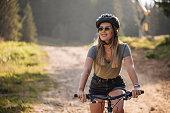 istock Gorgeous woman riding a bike 1183836468
