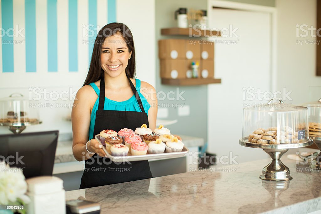 gorgeous woman selling cupcakes royalty free stock photo