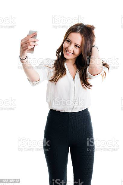 Gorgeous woman taking a selfie picture id535165455?b=1&k=6&m=535165455&s=612x612&h=p2n qqb0 kdsozuehzcjpqixa9afemad4slj kz2ata=