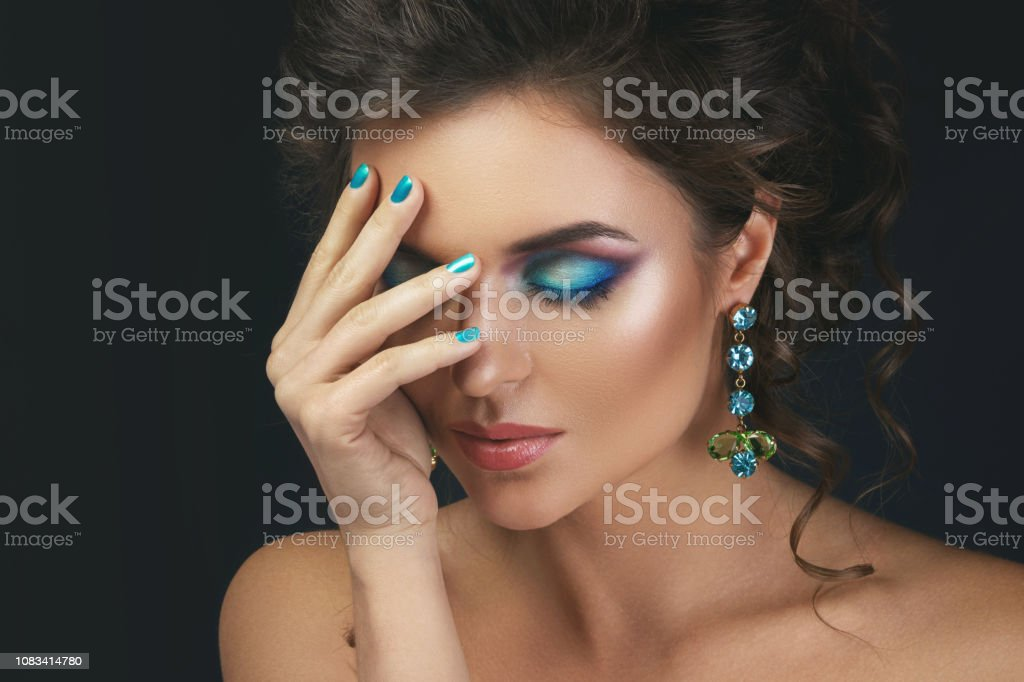 Gorgeous woman with a beautiful make-up and hairstyle wearing...