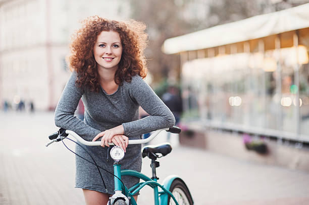 Gorgeous woman with bike stock photo