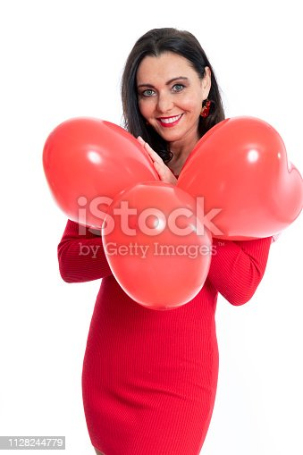 579443552istockphoto Gorgeous woman with heart shaped ballons on white background 1128244779
