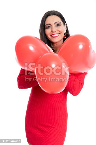 579443552istockphoto Gorgeous woman with heart shaped ballons on white background 1128244787
