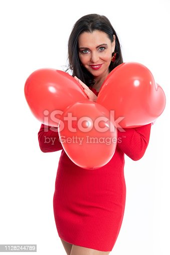 579443552istockphoto Gorgeous woman with heart shaped ballons on white background 1128244789
