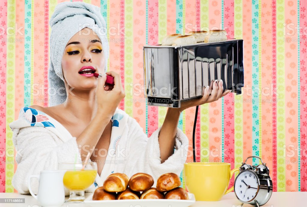 Gorgeous woman's, breakfast lipstick and toaster. stock photo