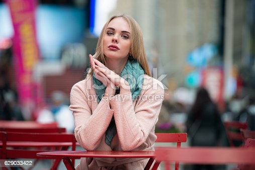 istock Gorgeous young blonde woman sitting outdoors on city street cafe 629033422