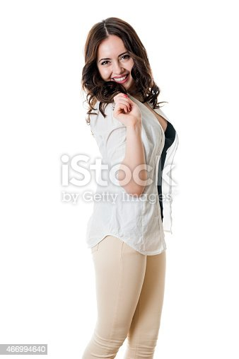 506152431istockphoto Gorgeous young brunette playing with her long hair 466994640